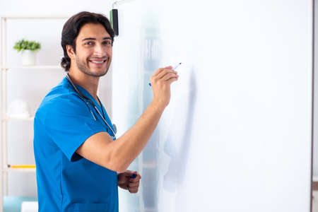 Foto de Young male doctor in front of whiteboard - Imagen libre de derechos