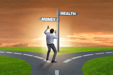 Photo for Businessman choosing between money and health - Royalty Free Image