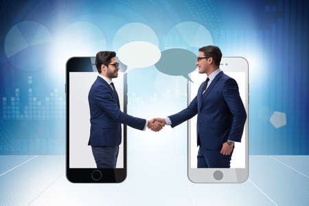 Photo for Concept of communication with businessmen handshaking - Royalty Free Image