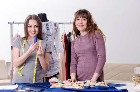Photo pour Young beautiful female tailor taking measurements - image libre de droit