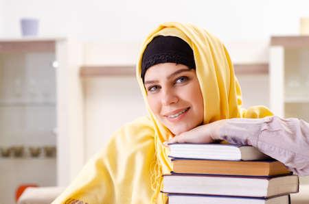 Photo pour Female student in hijab preparing for exams - image libre de droit