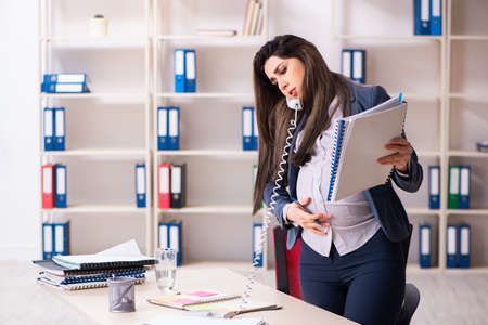 Photo for Young pregnant woman working in the office - Royalty Free Image