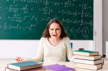 Foto de Young female math teacher in front of chalkboard - Imagen libre de derechos