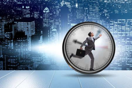 Photo pour Businessman employee in time management concept - image libre de droit