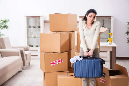 Photo for Young woman moving to new flat - Royalty Free Image