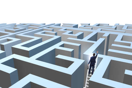 Photo pour Businessman trying to escape from maze - image libre de droit