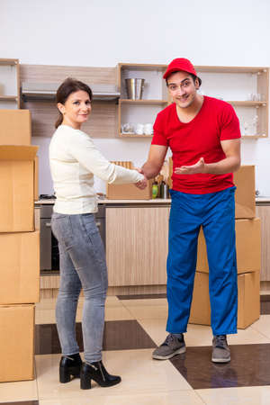 Photo pour Young male contractor and female customer in moving concept - image libre de droit