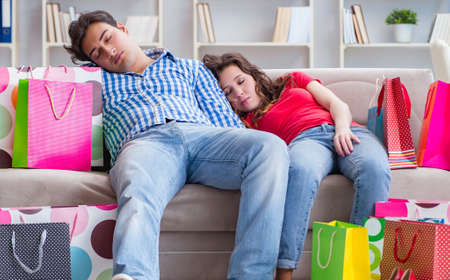 Photo for Young pair after shopping with many bags - Royalty Free Image