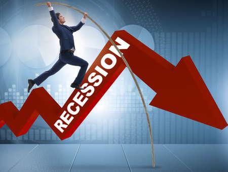 Photo pour Businessman pole vaulting over crisis in business concept - image libre de droit
