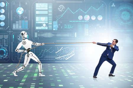 Photo pour Competition between humans and robots in tug of war concept - image libre de droit