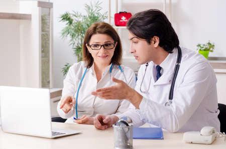 Photo pour Two doctors working in the clinic - image libre de droit