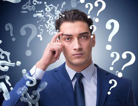 Photo pour Businessman in uncertainty concept with many unanswered question - image libre de droit