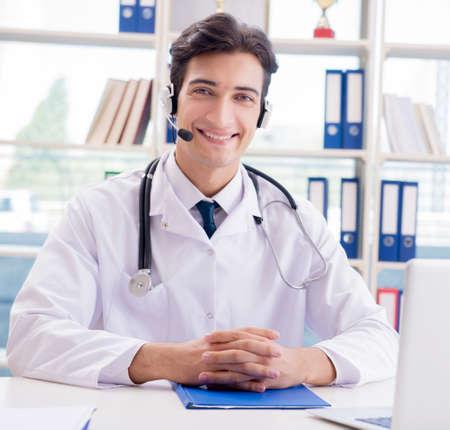 Photo pour Young male doctor in telehealth concept - image libre de droit