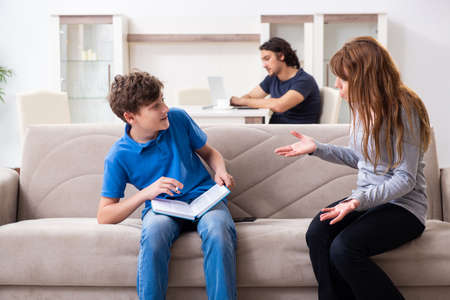 Photo pour Concept of underage smoking with young boy and family - image libre de droit