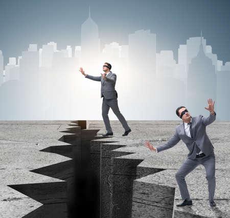 Foto de Blindfolded businessman in uncertainty concept - Imagen libre de derechos