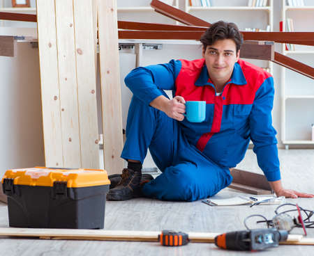 Photo pour Young carpenter with notebook writing planning at construction r - image libre de droit