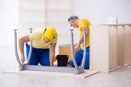 Photo for Two contractors carpenters working indoors - Royalty Free Image
