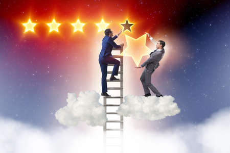 Photo for Businessman reaching out for stars - Royalty Free Image
