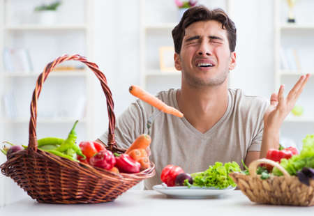 Photo pour Young man in healthy eating and dieting concept - image libre de droit