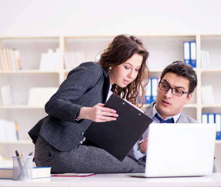 Photo pour Sexual harassment concept with man and woman in office - image libre de droit