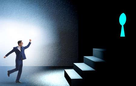Photo pour Businessman walking towards keyhole in challenge concept - image libre de droit