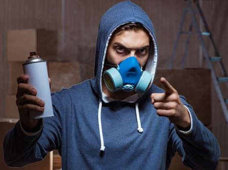 Foto de Graffiti painter in dark smokey room - Imagen libre de derechos