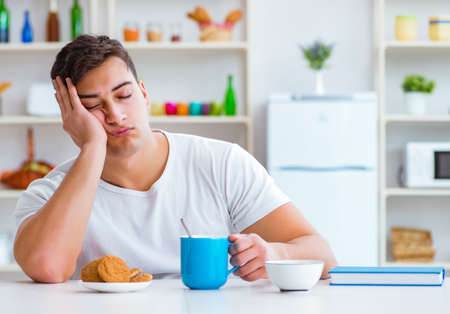 Photo for Man falling asleep during his breakfast after overtime work - Royalty Free Image