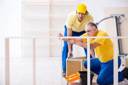Photo pour Two contractors carpenters working indoors - image libre de droit