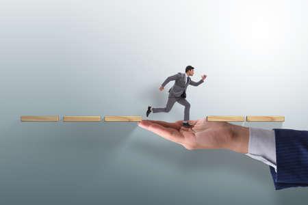 Photo pour Businessman in career support concept - image libre de droit
