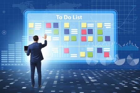 Photo pour Concept of to do list with businessman - image libre de droit