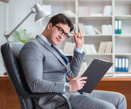 Photo for The young businessman working in the office - Royalty Free Image