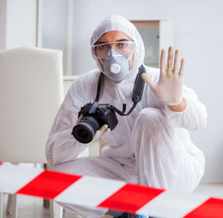Photo for Forensic expert at crime scene doing investigation - Royalty Free Image