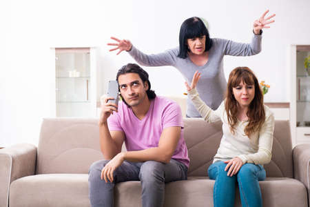 Photo pour Young family and mother-in-law in family issues concept - image libre de droit