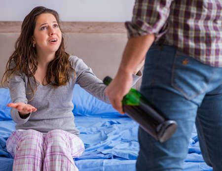 Photo pour Domestic violence concept in a family argument with drunk alcoho - image libre de droit