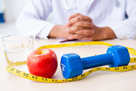 Photo pour Young male doctor in sport and dieting concept - image libre de droit