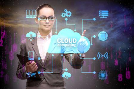 Photo pour Cloud computing concept with woman pressing buttons - image libre de droit