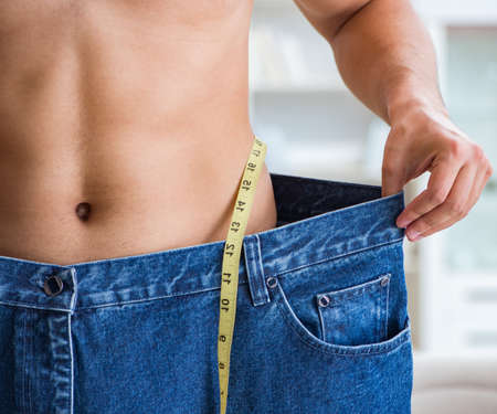 Photo pour The man in oversized pants in weight loss concept - image libre de droit