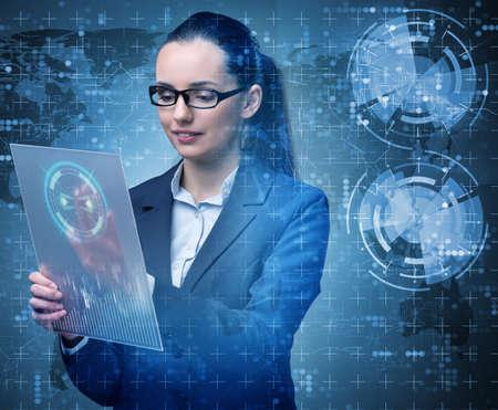 Photo pour Businesswoman with tablet in business concept - image libre de droit