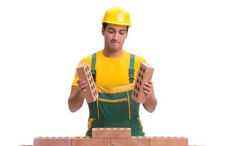 Photo pour The handsome construction worker building brick wall - image libre de droit