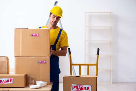 Photo for Young male professional mover doing home relocation - Royalty Free Image