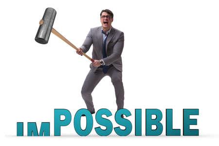 Photo pour Businessman hitting the word impossible with hammer - image libre de droit