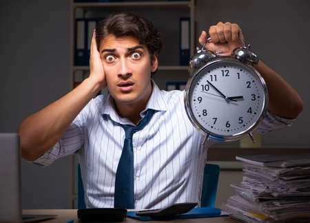 Photo pour Young financial manager working late at night in office - image libre de droit