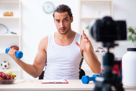 Photo for Young male blogger in dieting concept - Royalty Free Image