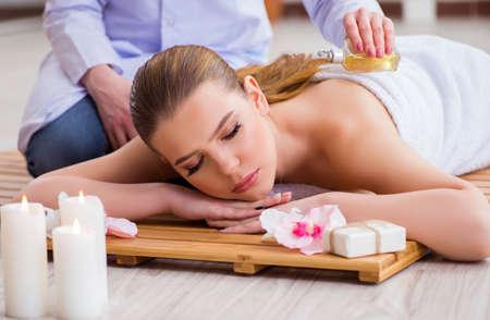 Photo pour Young woman during spa procedure in salon - image libre de droit