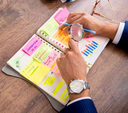 Photo pour Young handsome employee planning his work activity - image libre de droit