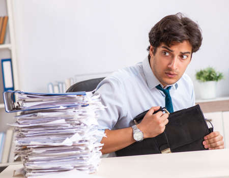 Photo for Overloaded busy employee with too much work and paperwork - Royalty Free Image