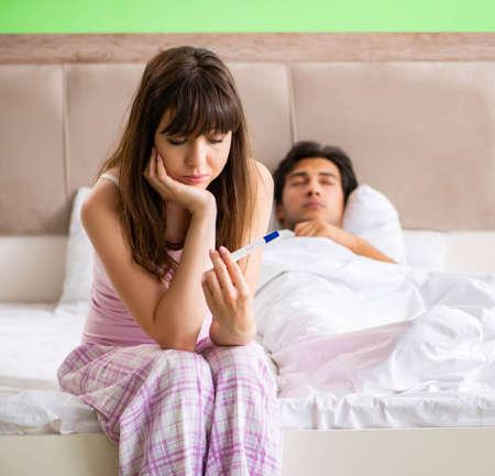 Photo pour Young married woman with pregnancy results test - image libre de droit