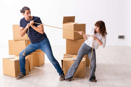Photo for Young pair and many boxes in divorce settlement concept - Royalty Free Image