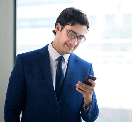 Photo for Young handsome businessman standing at the window - Royalty Free Image