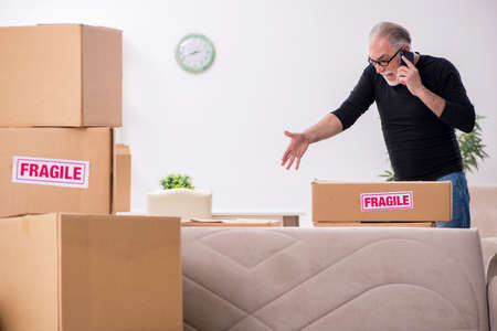 Photo for Old male professional mover doing home relocation - Royalty Free Image